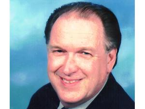 Charles E. Real